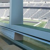 Stadium wall expansion joints in box suite window wall Seismic Colorseal DS EMSEAL