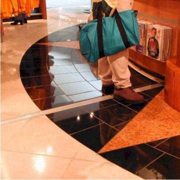 Expansion joint covers Migutrans FS 75 handles retail traffic at Orlando Airport Southwest terminal.