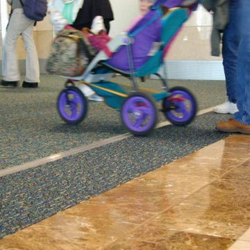 Expansion joint covers Migutrans FS 75 handles stroller traffic at Orlando Airport Southwest terminal.