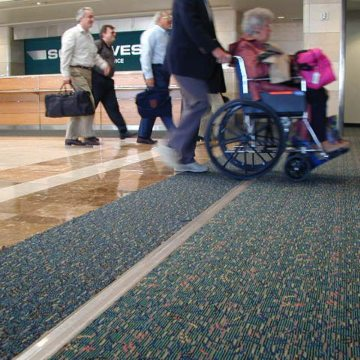 Expansion joint covers FS 75 handles wheelchair traffic at Orlando Airport Southwest terminal.