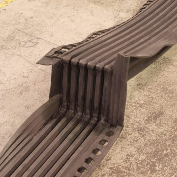 Thermaflex reverse deck-to-wall vertical transition used at support column.