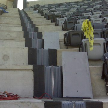 Continuity of seal from top of stadium to bottom of each seating level is assured with factory-fabricated SJS sections. Plates are seen at right ready for installation