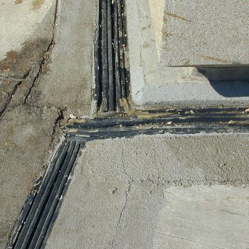 Failed stadium plaza deck expansion joint