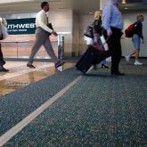 Expansion joint covers Migutrans FS 75 handles luggage traffic at Orlando Airport Southwest terminal.