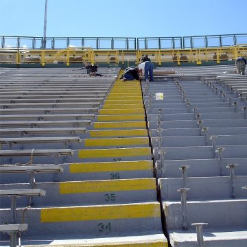 The failed liquid sealant and backer rod is removed from the tread and riser joints and the joint faces are cleaned back to concrete at the Green Bay Packers' Lambeau Field.