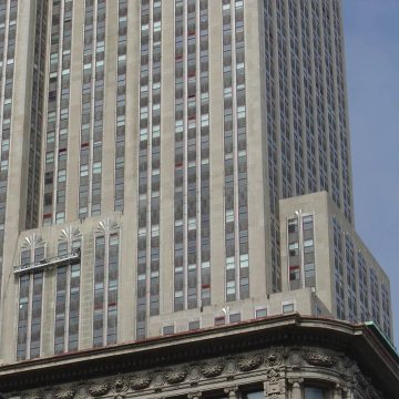 Swing stages look tiny against the massive facade of the Empire State Building as crews work to reseal the 6,514 window perimeters using EMSEAL's BACKERSEAL behind silicone liquid sealant.