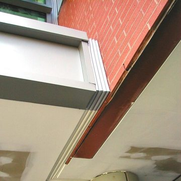 Color switching with Colorseal makes tidy work of matching a transition from metal panels to a drywall soffit.