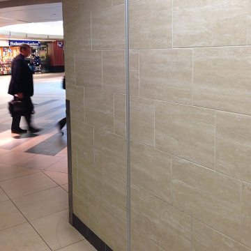 Migutrans FS 50 wall expansion joint installed with tile at Nashville International Airport