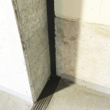 Fire rated wall to floor expansion joint - Emshield DFR transition to WFR fire rated expansion joint fire barrier by EMSEAL