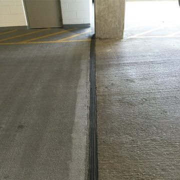 EMSEAL's Emshield DFR fire-rated parking expansion joint with column and wall.