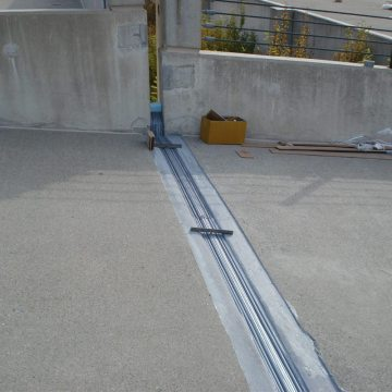 Hundreds of feet of deck expansion joint at the vast parking facility of the Morris Crossroads Corporate Center was replaced using the Seismic Joint System-SJS from EMSEAL.