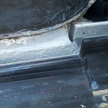Plaza deck expansion joint sealing: DSM-FP in plaza to wall expansion joint epoxy on legs 2 Houston Center EMSEAL