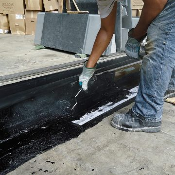DSM-FP in plaza to wall expansion joint applying hot rubberized asphalt 2 Houston Center EMSEAL