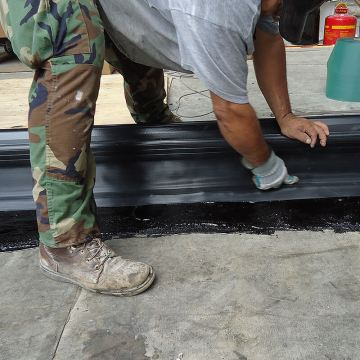 DSM-FP in plaza to wall expansion joint firmly embedding side sheet 2 Houston Center EMSEAL