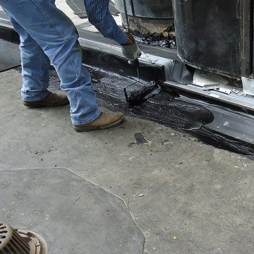DSM-FP in plaza to wall expansion joint top coat hot rubberized asphalt 2 Houston Center EMSEAL