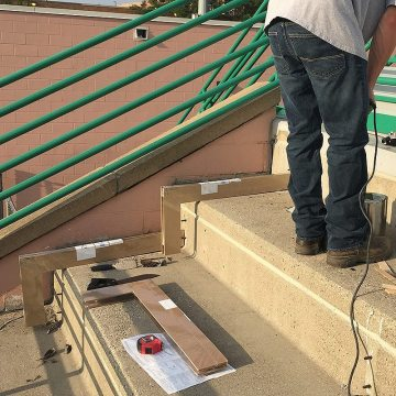 Mixing epoxy for the installation of EMSEAL's DSM Custom 90s for South Side Archers Stadium.