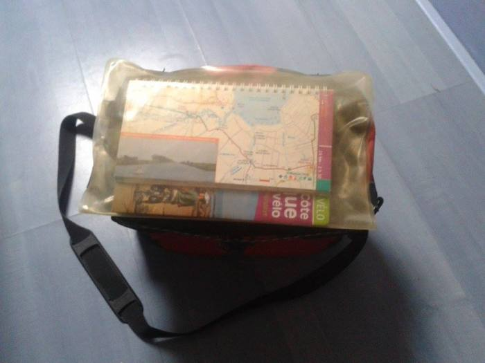 topo guide dans sacoche guidon