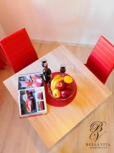 Table for Two in Apartment in Blagoevgrad Bulgaria Furnished Milano with Magazine and Fruits