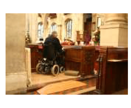 Photo of a church worshipper in a wheelchair