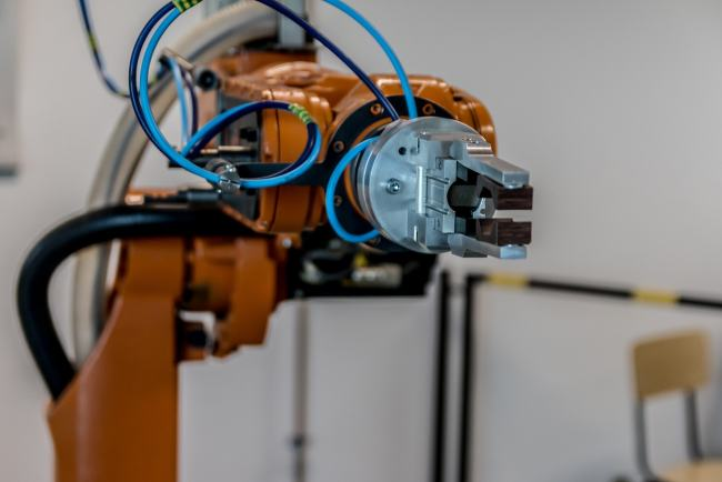 A picture of a manufacturing floor robot arm where collaborative robotics are in use