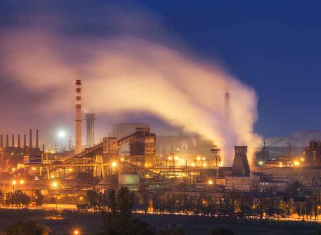 A photo of a metal foundry at night, one of the largest industries affected by US-China Trade.