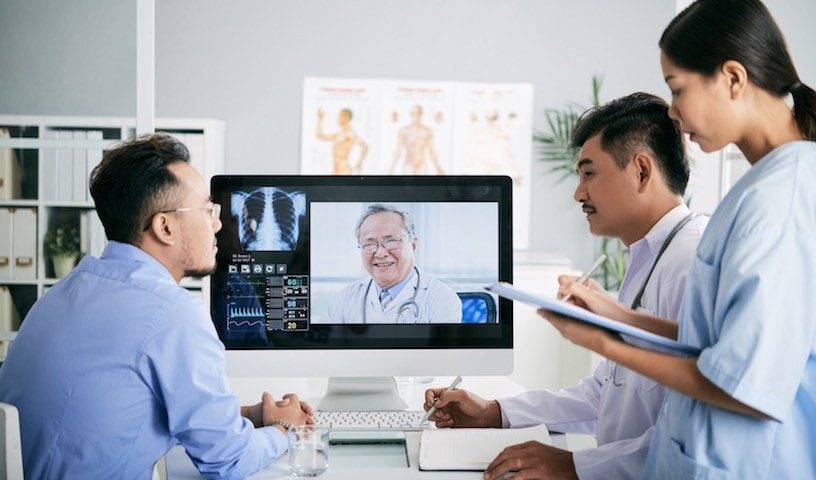 an image of healthcare professionals and patients leveraging 5g wireless technology