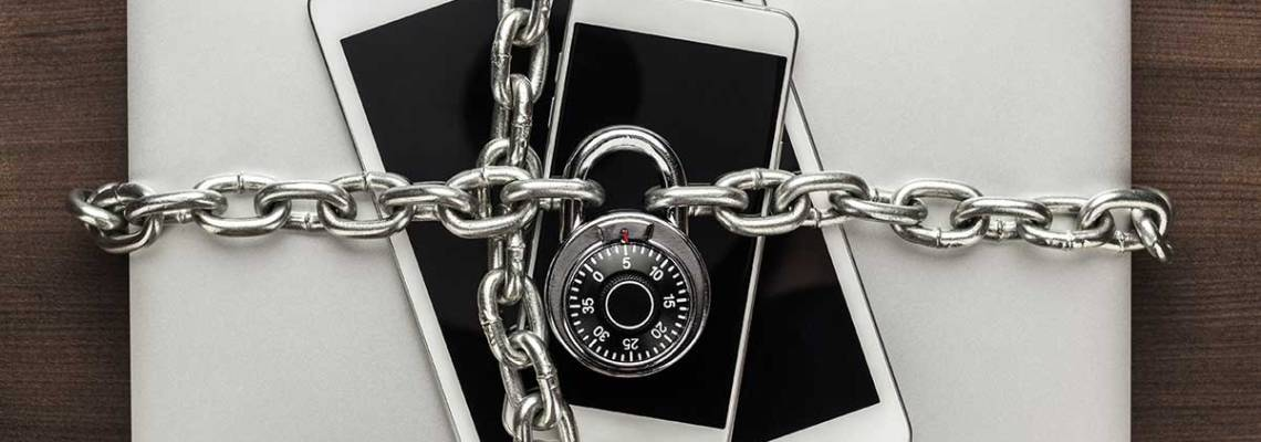 an image of computers, phones, and tablets under lock and key as part of 7 simple ways to keep your data safe