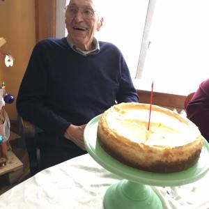 Celebrating his 90th birthday with homemade cheesecake.