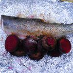 roasted over a campfire fresh trout with beets and garlic