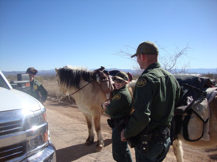 "Equestrian Border Patrol stopping to visit. I had left my tent in Douglas in the livestock feed trough and the ""BPer's"" came to my rescue, went back and retrieved it."