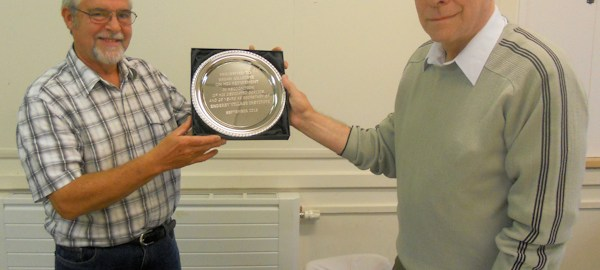 Brian Gillespie receives commemorative plate