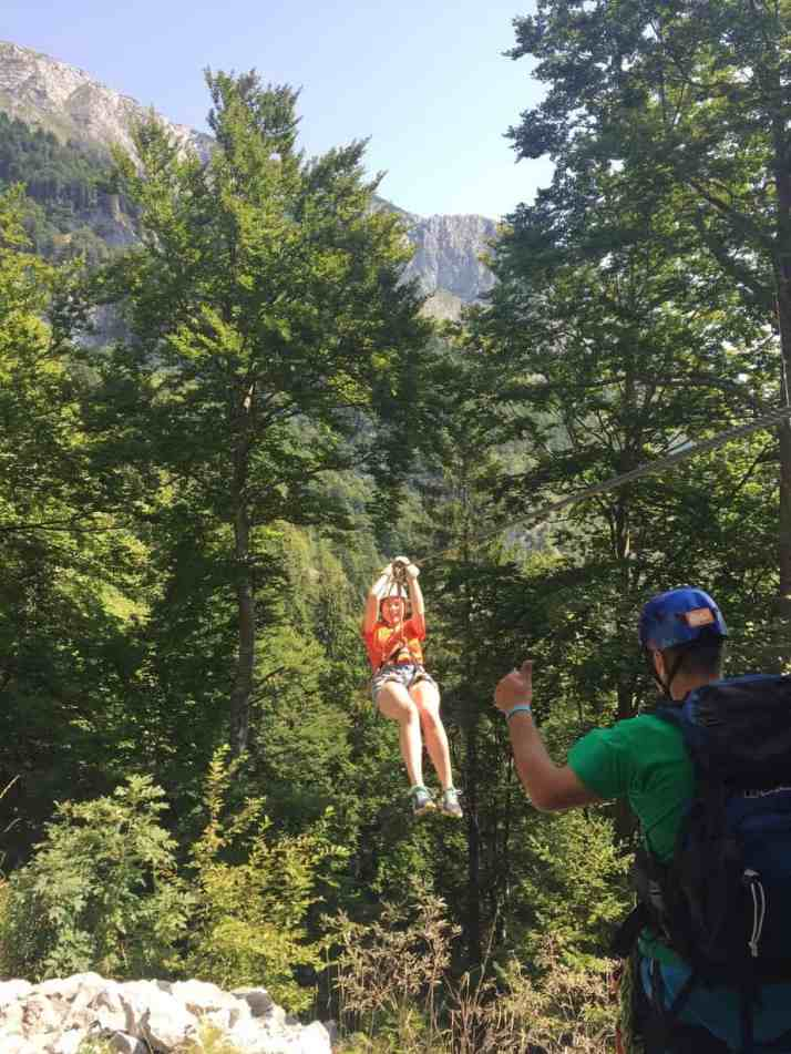 Me returning to land after ziplining, getting the thumbs up from our guide. You can't go to Slovenia without ziplining with Aktivni Planet in Europe's biggest zipline park. Ziplining in Slovenia is unlike anything else.