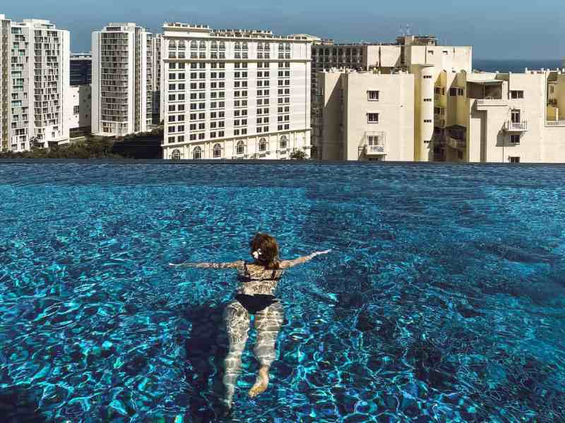 Swimming at the rooftop infinity pool at Somerset Greenways in Chennai India.