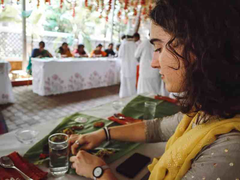 Alexia demonstrated eating off a banana leaf in south India.