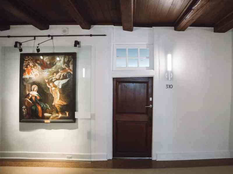Hallway with wooden door and painting