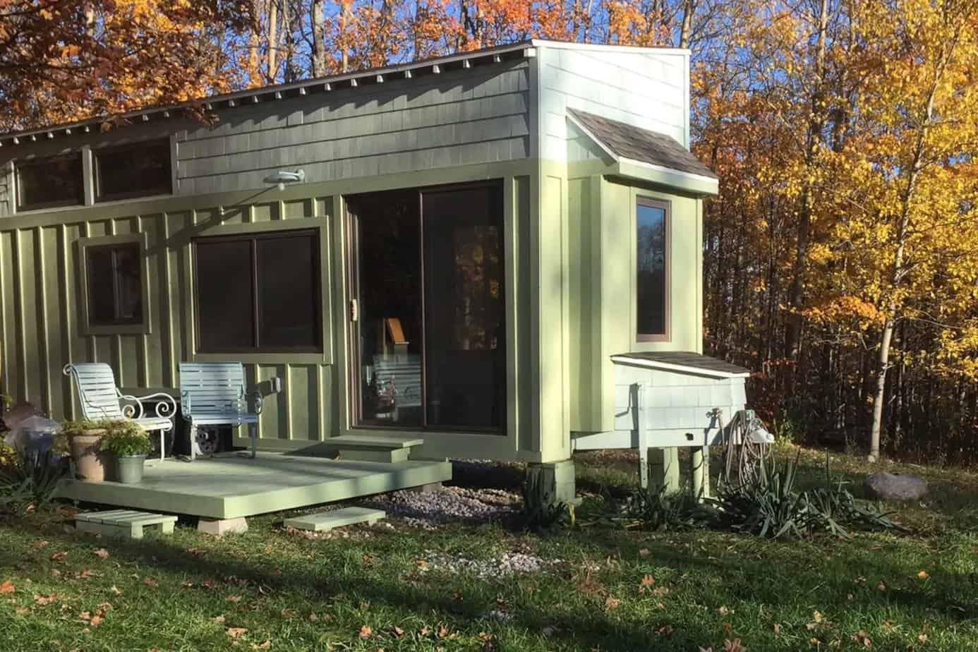 A pale green tiny house in Leelanau Michigan.