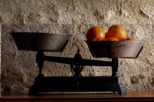 Old balance and oranges