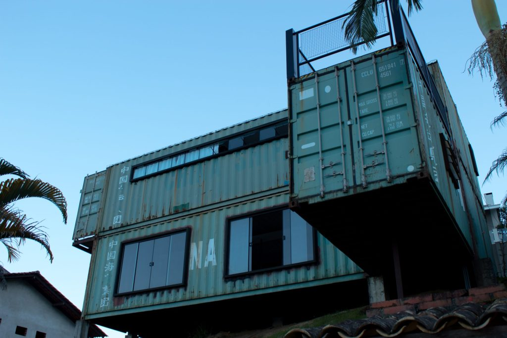 Stacked shipping containers are made into a unique house.