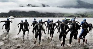 Athletes start the swim course during the Challenge Walchsee-Kaiserwinkl Triathlon on September 3, 2017 in Walchsee, Austria. Photo by Stephen Pond/Getty Images