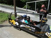 George Jordan family in bobsled at Ironman® Lake Placid