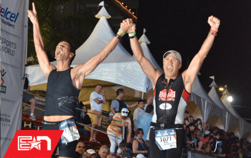 Two Team Endurance Nation members cross the finish at the same time. You too can finish an Ironman, but it all starts in the OutSeason.