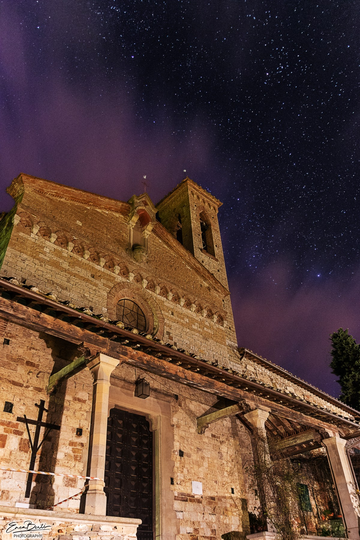 Unknown church under a cloudy and starry night