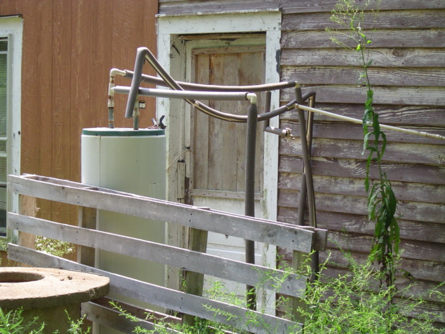 An outdoor electric water heater disgrace