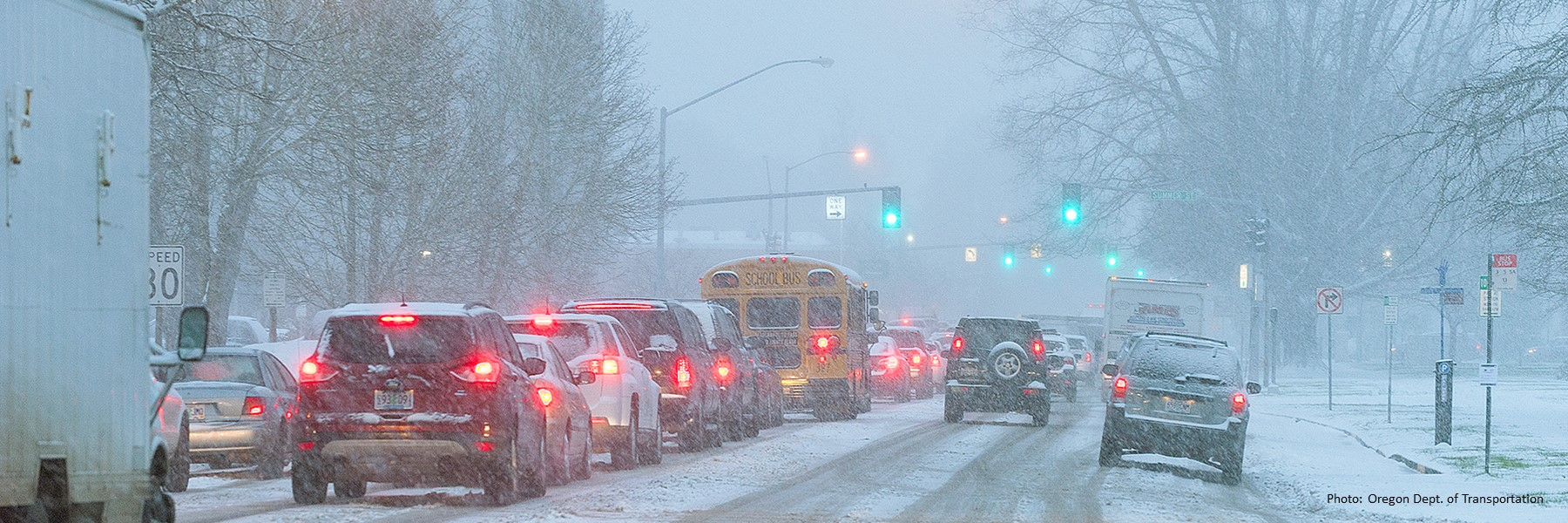 Cars driving in snow.