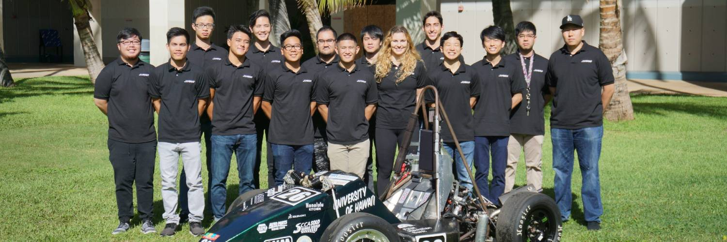 Group Photo Of UH SAE Formula Team With Their Car.
