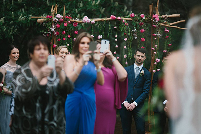 wedding guests with mobiles