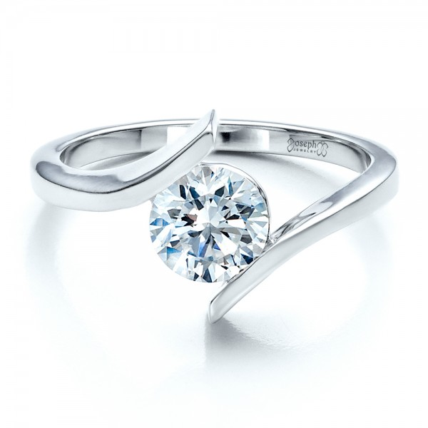 http://www.jordanjewellery.com/all-about-tension-set-engagement-rings/