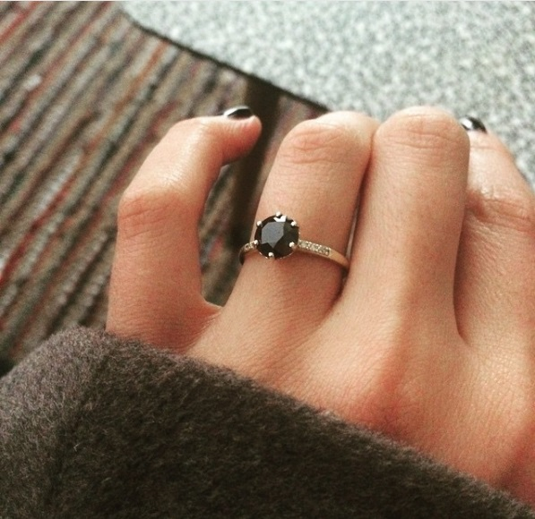 black diamond ring on hand