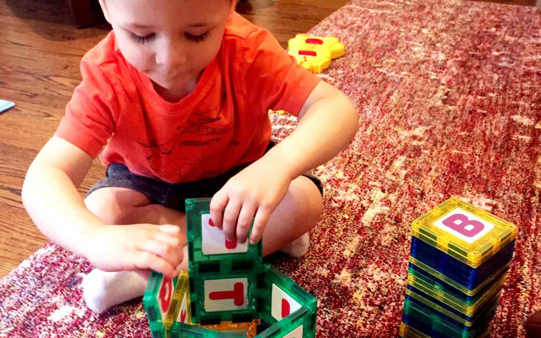 Easy and fun tower building activity to teach toddlers about shapes and gravity