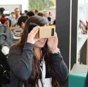 A Girl Checking Out Google Cardboard :) - Pic by mashable.com